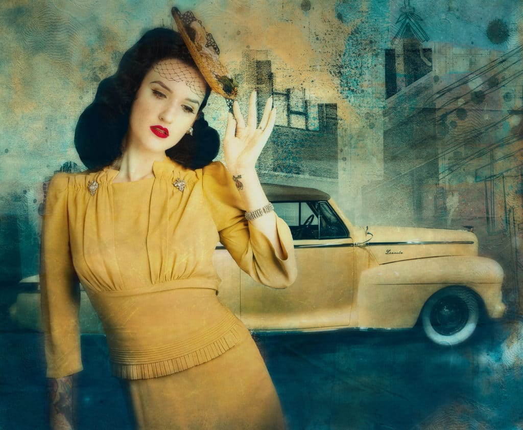 A Vintage Moment depicts stylish woman in yellow dress in front of 1930's car.